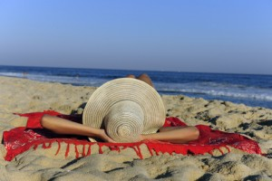 http://www.dreamstime.com/royalty-free-stock-photos-woman-lying-beach-relaxing-image13401538